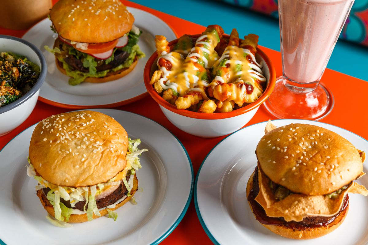 """Assorted burgers, """"messy fries,"""" and an oat milk strawberry shake at Lekka Burger"""