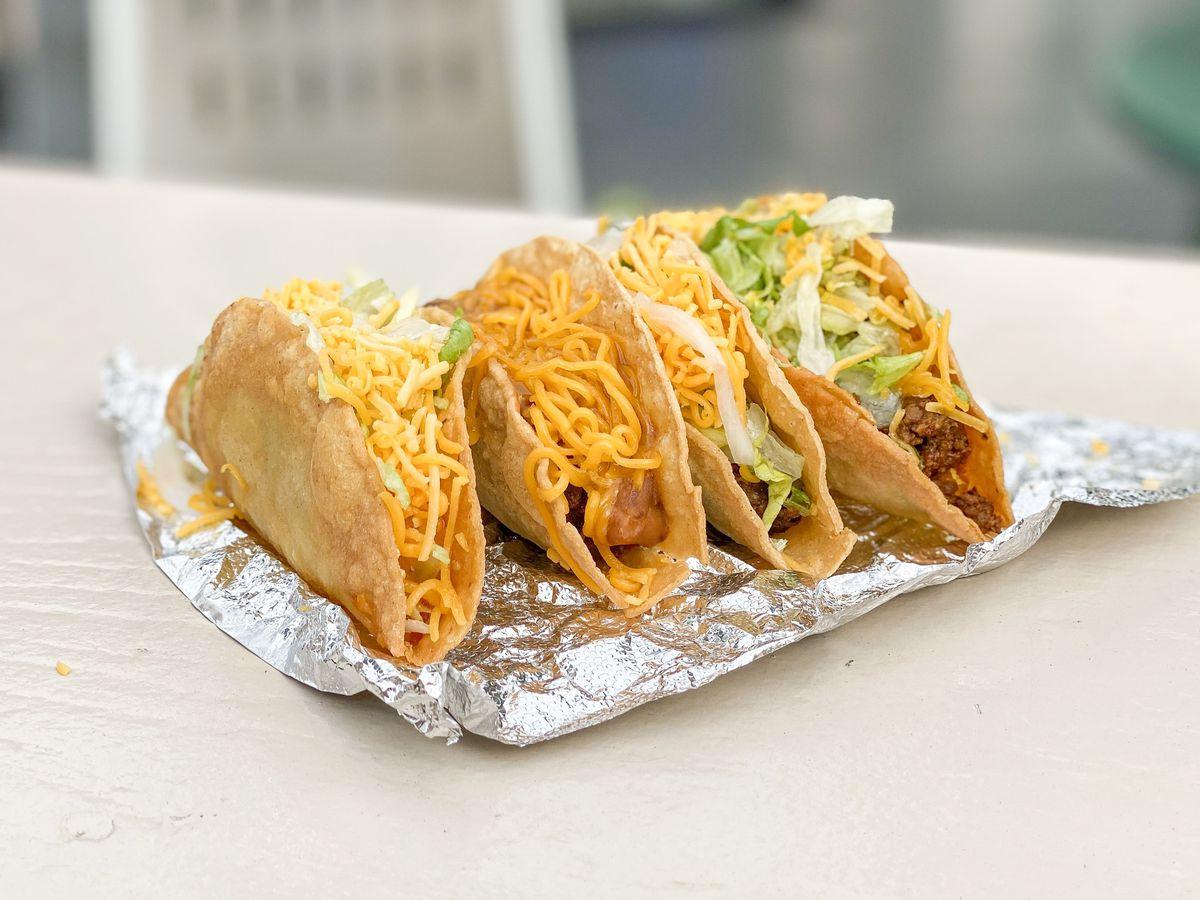 A tray full of tacos.