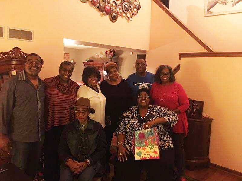 Patricia Frieson, seated right, with bag, and her 8 living siblings. | Provided ORG XMIT: JWv7RlJXnhWJeK69m_zL