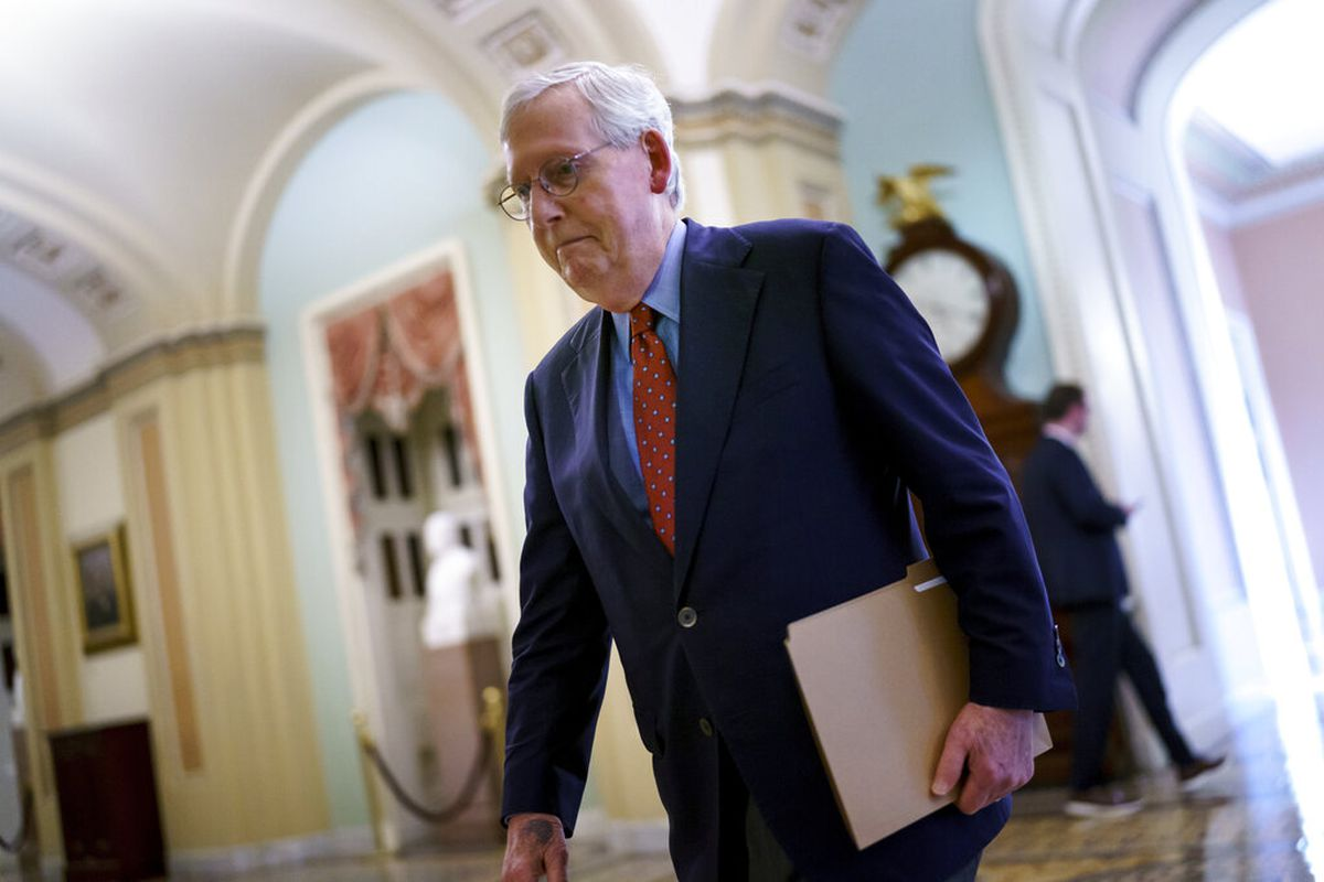Senate Minority Leader Mitch McConnell, R-Ky., walks to the chamber at the Capitol in Washington.