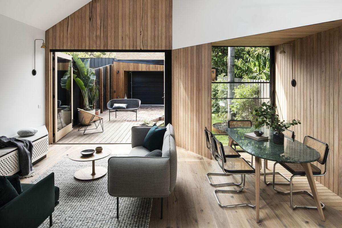 Living room with doors open to backyard.