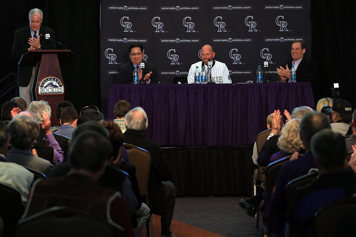 Jay Alves (left) along with Bill Geivett and Dick Monfort introduces new Rockies manager Walt Weiss.