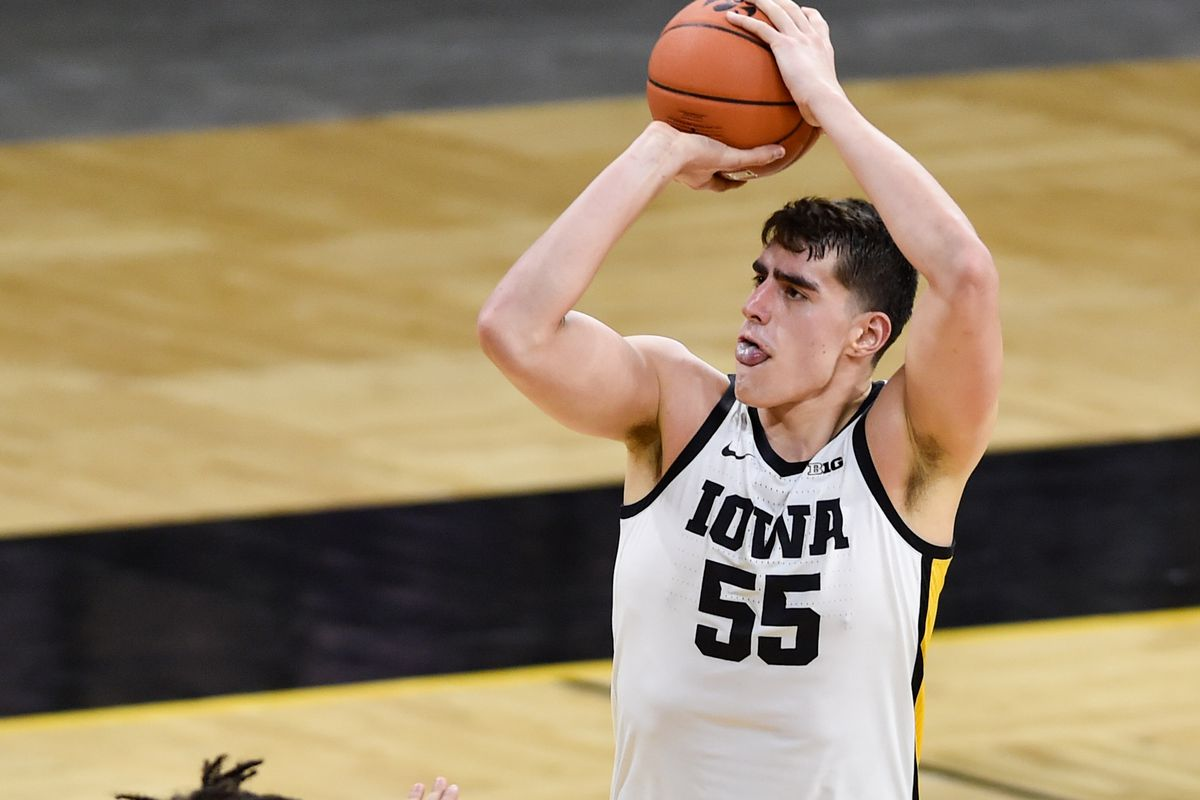 Iowa Hawkeyes center Luka Garza shoots a three-point basket as Rutgers Scarlet Knights guard Caleb McConnell defends during the second half at Carver-Hawkeye Arena.