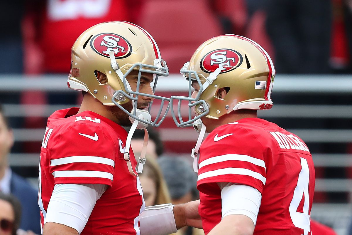 San Francisco 49ers quarterback Jimmy Garoppolo greets teammate Nick Mullins before their game against the Green Bay Packers in the NFC Championship game at Levi's Stadium in Santa Clara, Calif., on Sunday, Jan. 19, 2020.