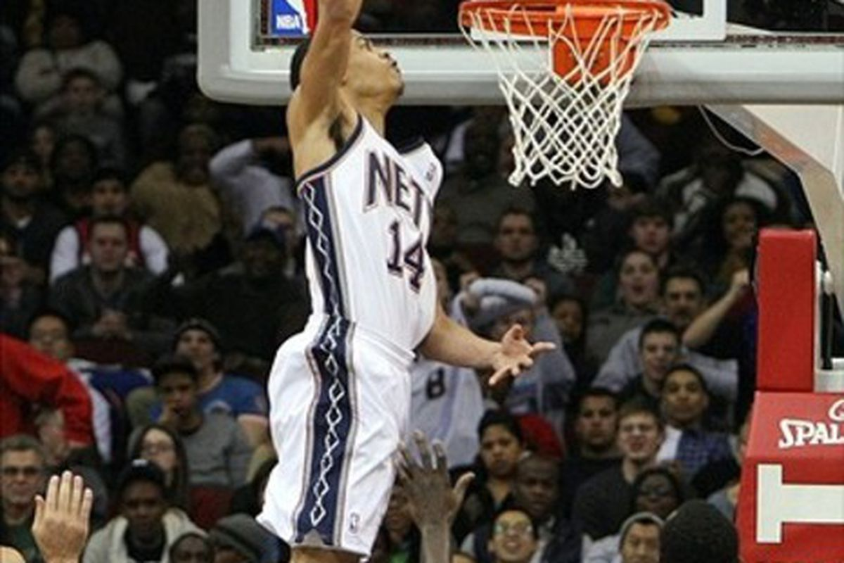 Mar 10 2012; Newark, New Jersey, USA; New Jersey Nets shooting guard Gerald Green (14) dunks over Houston Rockets center Samuel Dalembert (21) during the second half at the Prudential Center.  Mandatory Credit: Alan Maglaque-US PRESSWIRE
