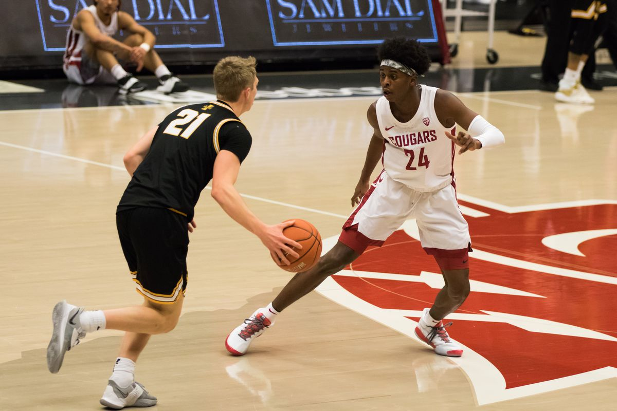 PULLMAN, WA - DECEMBER 9: Washington State guard Noah Williams (24) backpedals on defense during the first half of the Battle of the Palouse rivalry between the Idaho Vandals and the Washington State Cougars on December 9, 2020, at Beasley Coliseum in Pullman, WA.