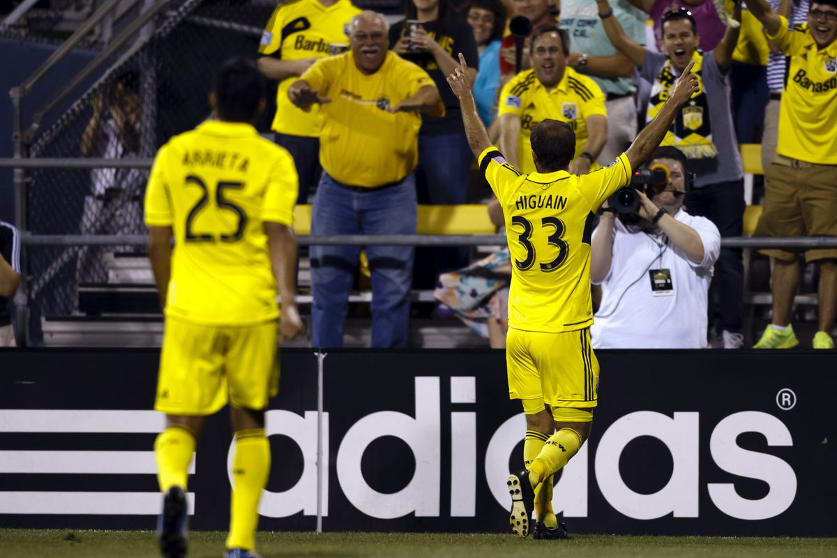 Federico Higuain celebrates his delicate chip in the last league meeting between the two - here be danger