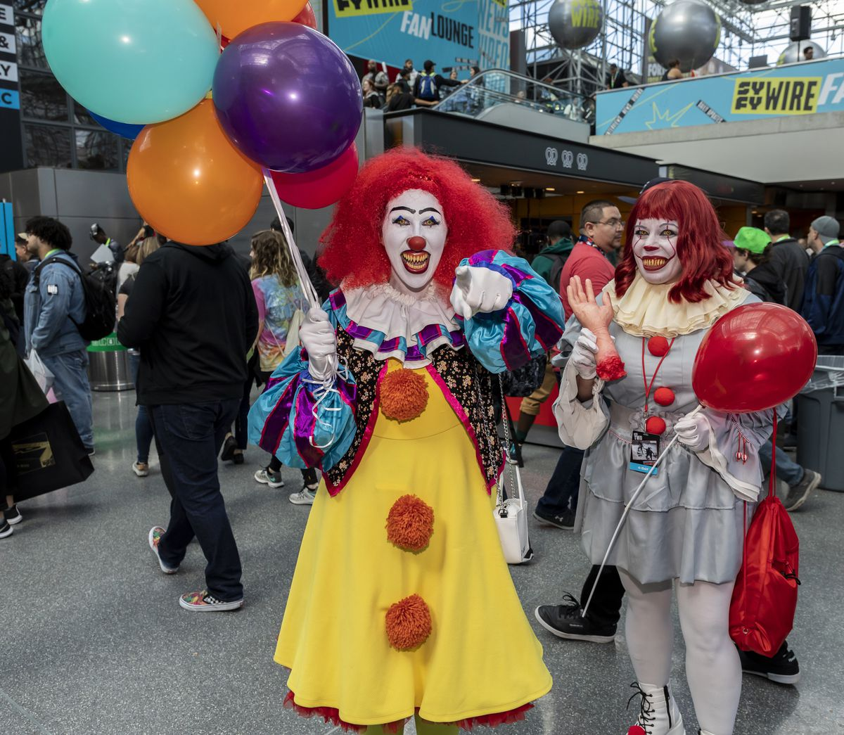 Comic Con attendees pose in the costumes during Comic Con...