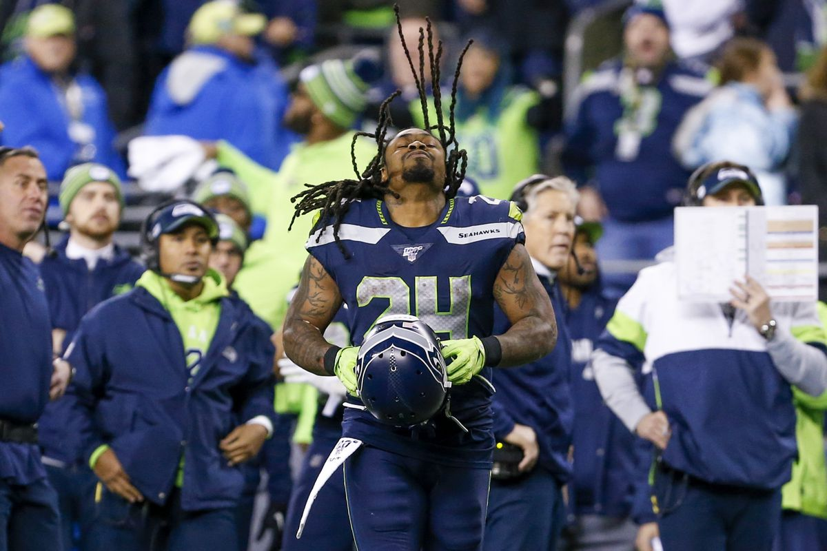 Seattle Seahawks running back Marshawn Lynch puts on his helmet during the fourth quarter against the San Francisco 49ers at CenturyLink Field.