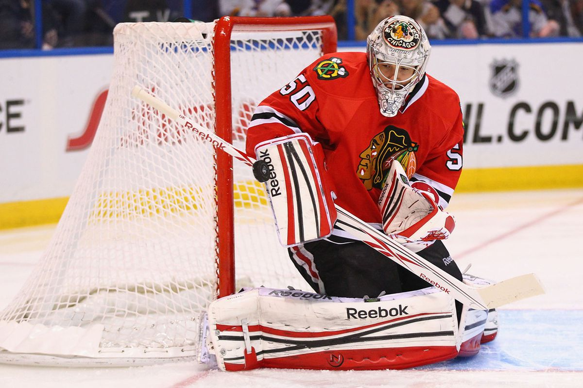 ST. LOUIS, MO - NOVEMBER 8: Corey Crawford #50 of the Chicago Blackhawks makes a save against the St. Louis Blues at the Scottrade Center  on November 8, 2011 in St. Louis, Missouri.  (Photo by Dilip Vishwanat/Getty Images)