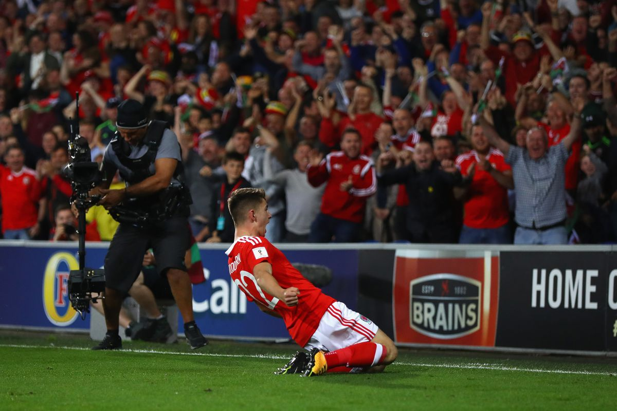 Woodburn produces magic in late rescue act for Wales