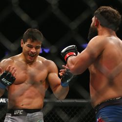 Costa smiles and challenges Hendricks to step into the pocket.