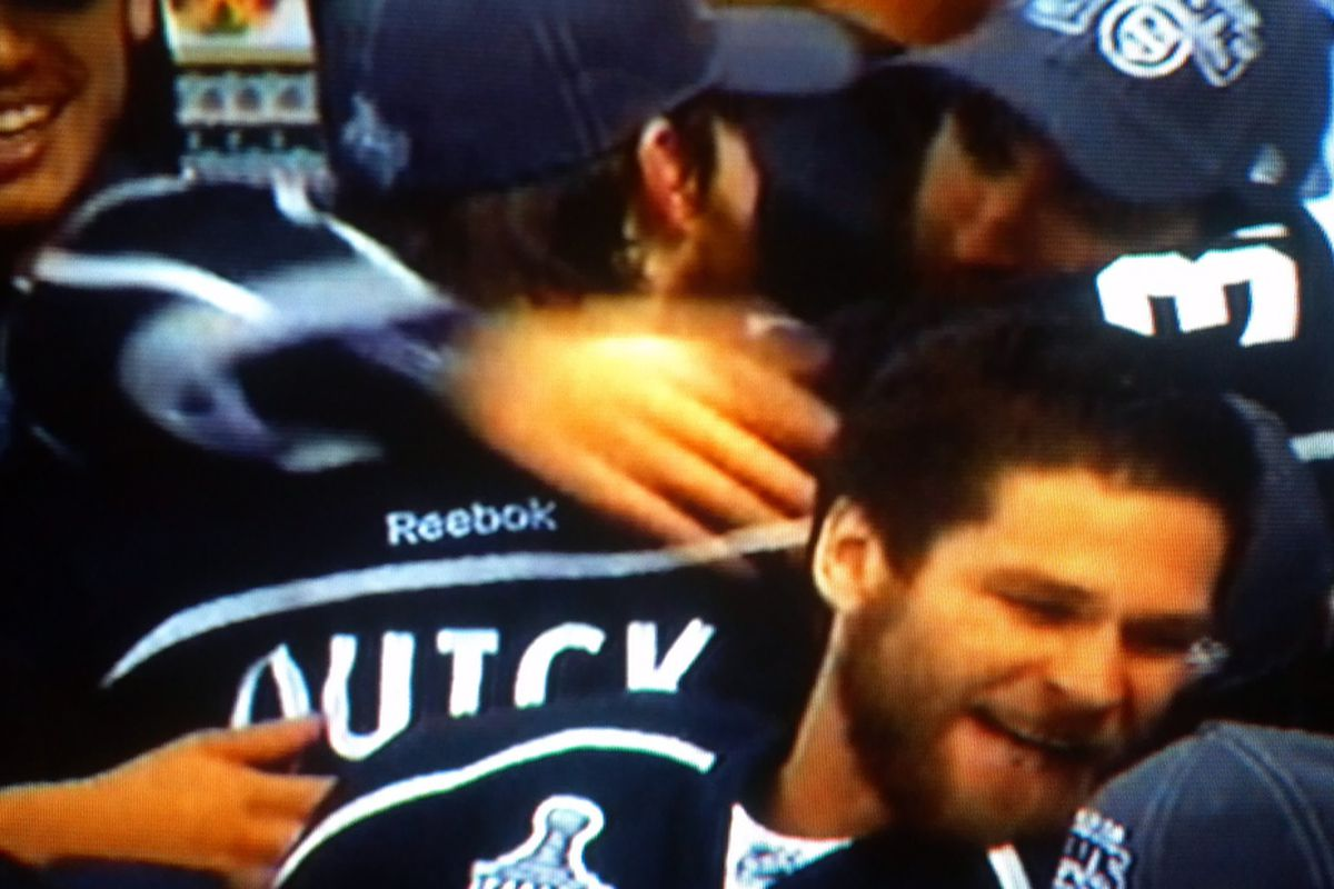Former Badger Davis Drewiske (bottom right) celebrates with teammates after winning the Stanley Cup Monday night.