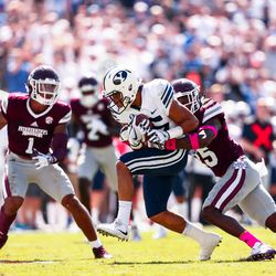 BYU wide receiver Aleva Hifo, center, runs with the ball after making a catch as Mississippi State's Lashard Durr, right, tries to make the tackle during the first half at Davis Wade Stadium in Starkville, Miss., on Saturday, Oct. 14, 2017.