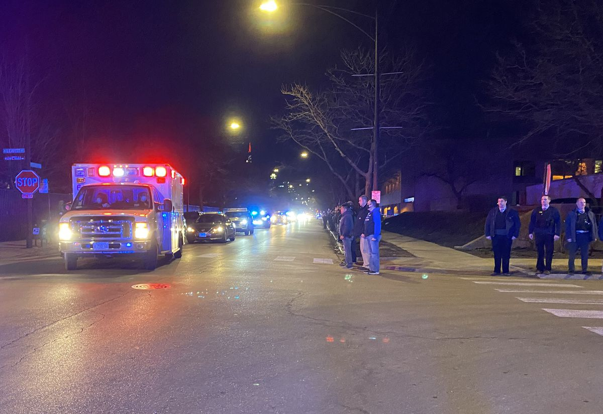 An ambulance carrying the body of a Chicago police officer arrives at the Cook County medical examiner's office Friday night, March 5, 2021. The officer died of an apparent suicide, according to CPD Supt. David Brown.