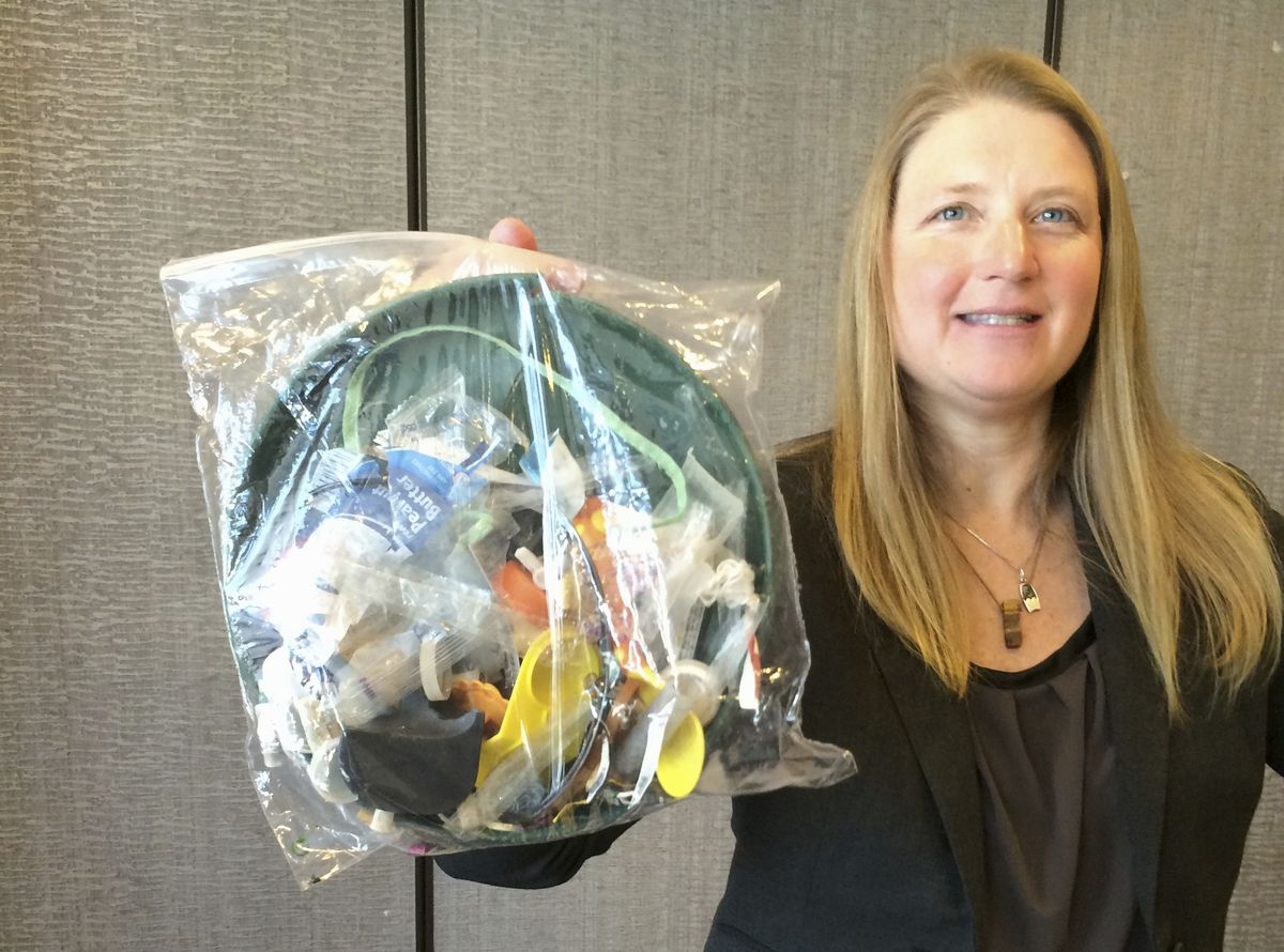 Jenna Jambeck, an environment engineering professor at the University of Georgia, holds a plastic baggie with trash collected from a clean up at Panama Beach, Fla., in 2015. | Associated Press file photo