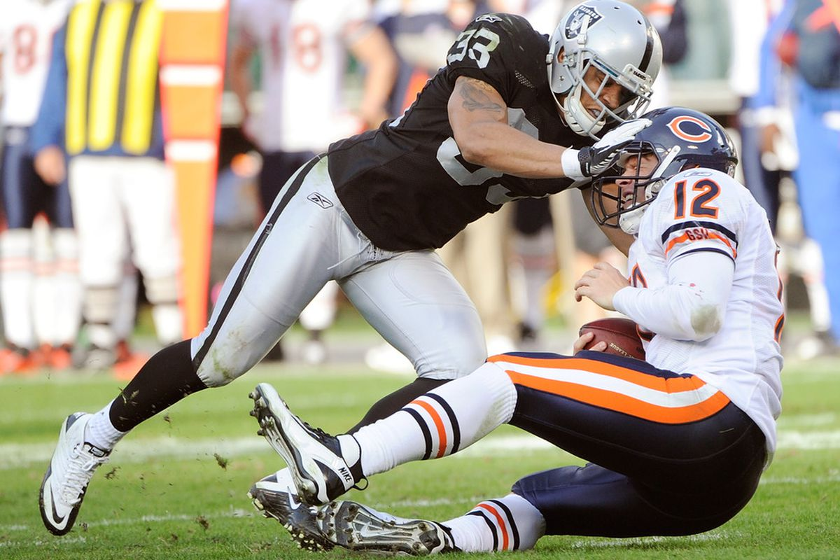 OAKLAND, CA - NOVEMBER 27:  Tyvon Branch #33 of the Oakland Raiders sacks quarterback Caleb Hanie #12 of the Chicago Bears at O.co Coliseum on November 27, 2011 in Oakland, California.  (Photo by Thearon W. Henderson/Getty Images)