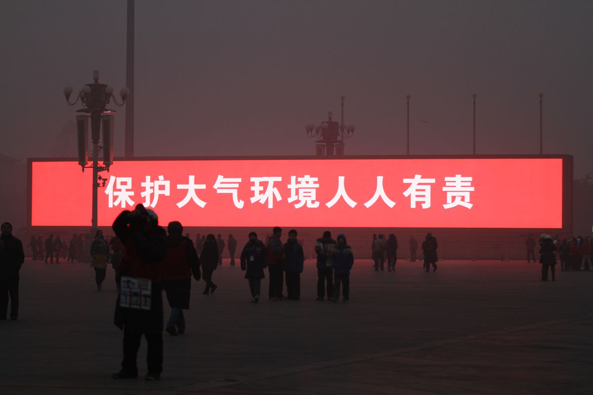 A sign urging environmental responsibility in Beijing's Tiananmen Square (ChinaFotoPress/ChinaFotoPress via Getty)