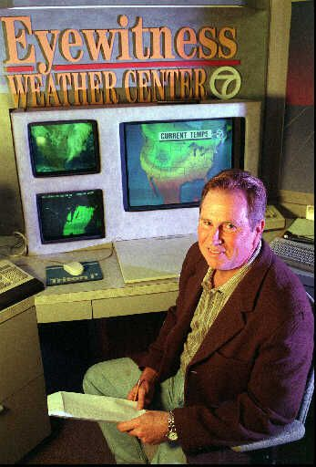 """Jerry Taft at the Channel 7 """"Eyewitness Weather Center"""" desk in 1997."""