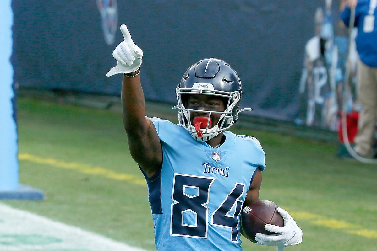 Corey Davis of the Tennessee Titans celebrates a touchdown against the Cleveland Browns in the second quarter at Nissan Stadium on December 06, 2020 in Nashville, Tennessee