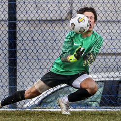 Brighton goal keeper Joe Barlow uses his face to deflect a shot on goal during a match against Skyline at the Cottonwood Heights Recreation Center on Friday, March 26, 2021.