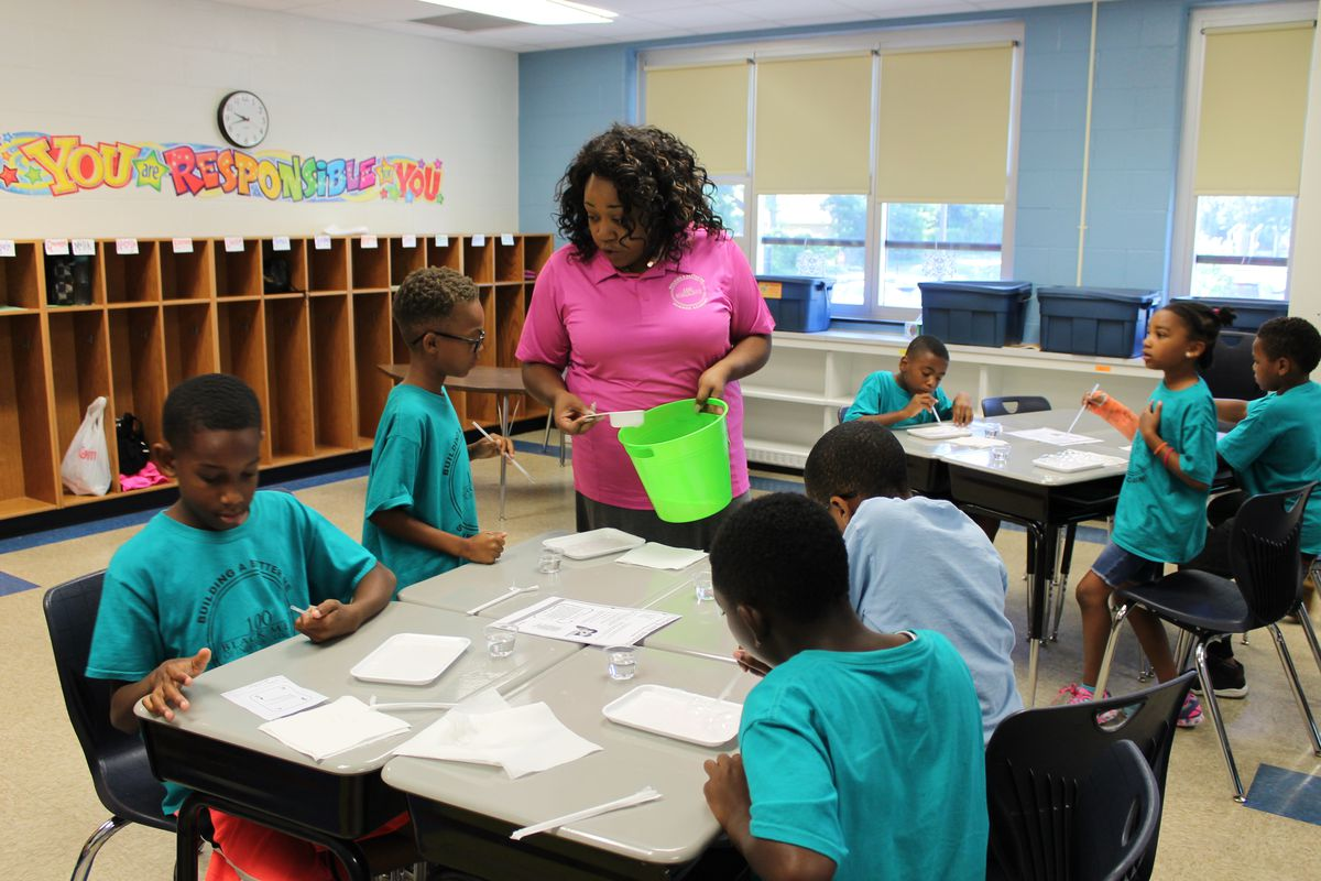 A teacher leads an activity  at the 100 Black Men of Indianapolis' Summer Academy at IPS School #74.