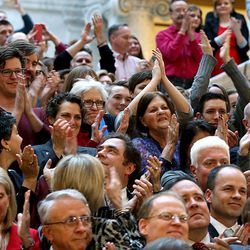 The crowd cheers as Gov. Gary Herber signs SB296 at the Capitol in Salt Lake City on Thursday, March 12, 2015.