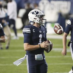 Brigham Young Cougars quarterback Jacob Conover (17), Brigham Young Cougars quarterback Zach Wilson (1) and Brigham Young Cougars quarterback Baylor Romney (16) warm up in Provo on Saturday, Oct. 24, 2020.