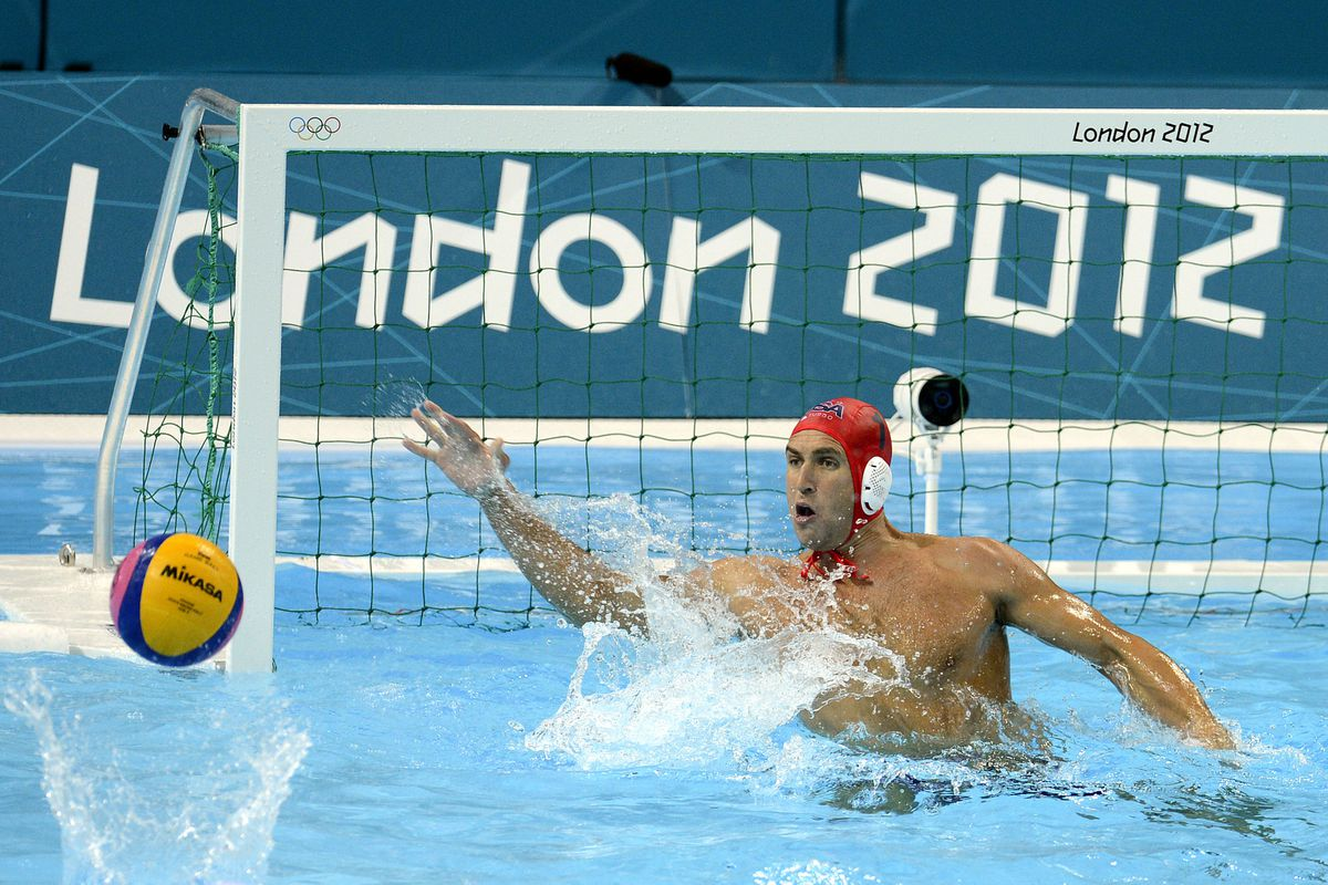 Jul 31, 2012; London, United Kingdom; USA goal keeper Merrill Moses (1) reaches out to block a shot from Romania during the London 2012 Olympic Games at Water Polo Arena. Mandatory Credit: John David Mercer-USA TODAY Sports