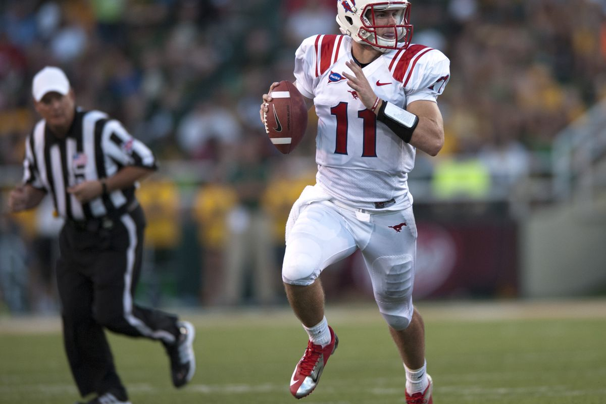 WACO, TX - SEPTEMBER 2: Garrett Gilbert #11 of the SMU Mustangs scrambles against Baylor University Bears on September 2, 2012 at Floyd Casey Stadium in Waco, Texas.  (Photo by Cooper Neill/Getty Images)
