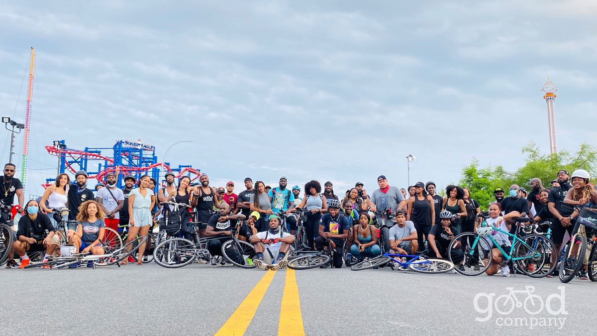 A group of cyclists sitting in the road near Coney Island
