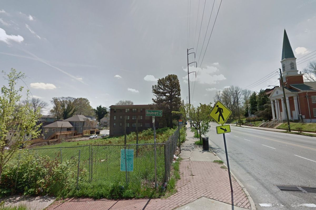 A street view of an empty lot and a church on the opposite side of Boulevard.