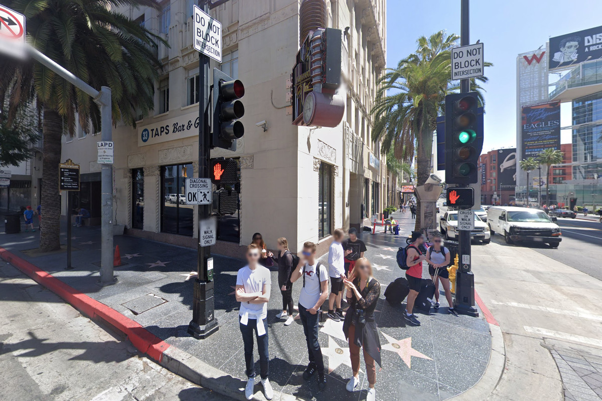 A roadside shot of tourists in Hollywood.
