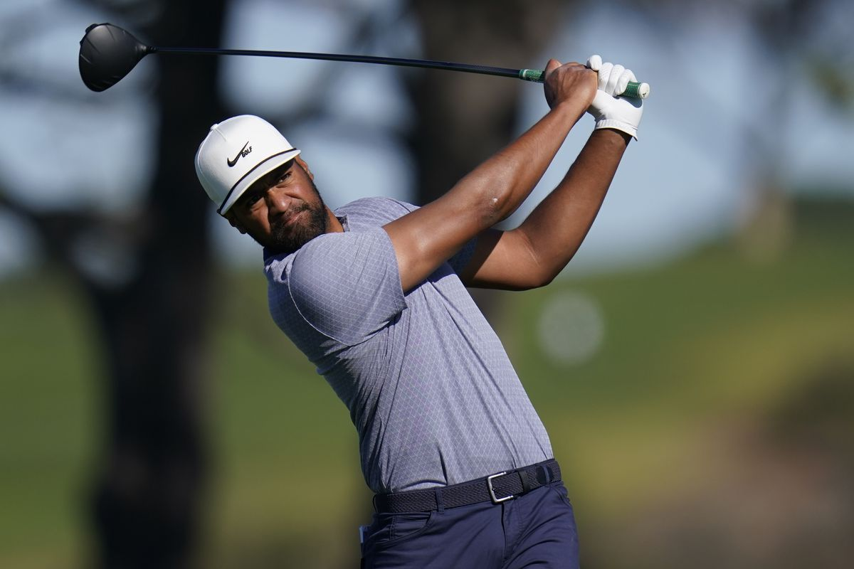 Tony Finau watches his tee shot on the fifth hole of Torrey Pines' South Course at the Farmers Insurance Open in San Diego.