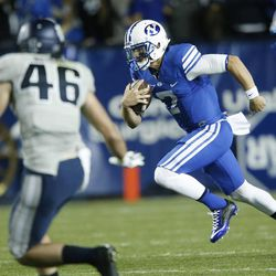 Brigham Young Cougars quarterback Christian Stewart (7) runs the ball after starter Taysom Hill was hurt in Provo Friday, Oct. 3, 2014.