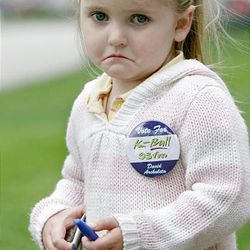 """Three-year-old Brinley Bettis, who was waiting patiently outside the K-Bull 93 FM studio for an autograph from """"American Idol"""" finalist David Archuleta, reacts when she finds out he had to skip the appearance after running late during his hectic schedule while in Salt Lake City Friday."""