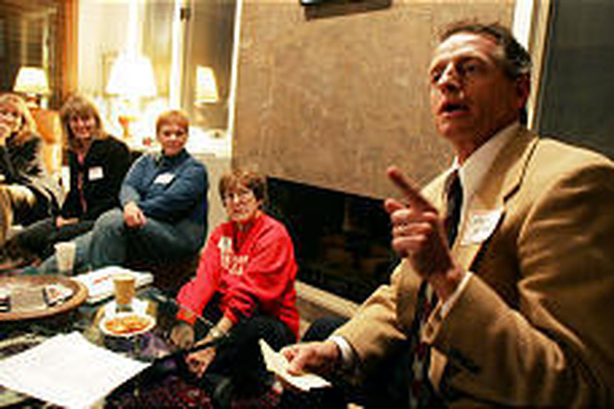 State Democratic Party Chairman Wayne Holland talks with fellow Democrats about plans and strategies for the 2006 election at a house party in Salt Lake Tuesday, one of 17 political house parties across the state.