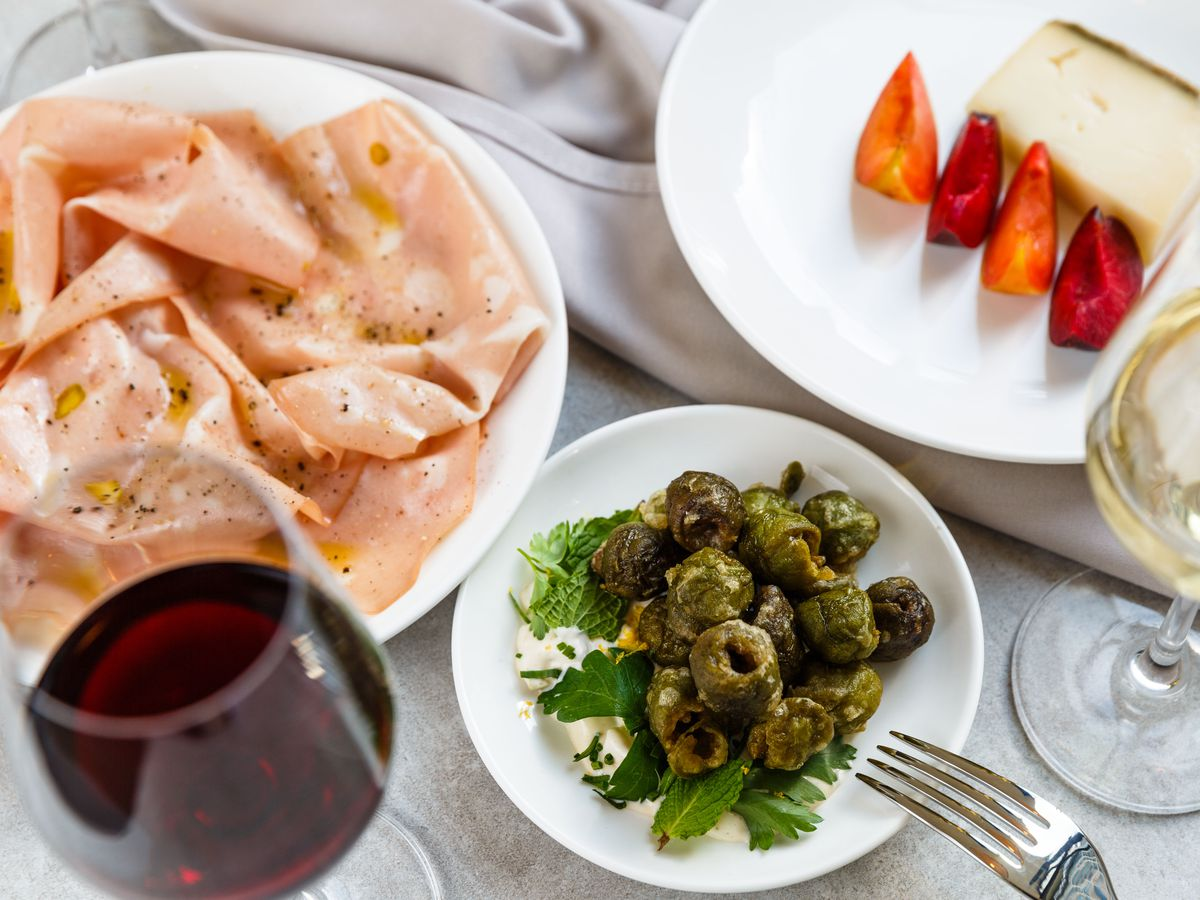 Fried green olives, mortadella with citrus aioli, and mistoa with plums at LaLou