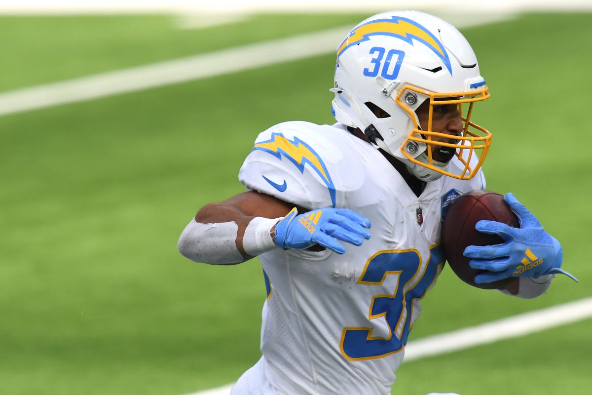 Running back Austin Ekeler #30 of the Los Angeles Chargers rushes against the Kansas City Chiefs during the second quarter at SoFi Stadium on September 20, 2020 in Inglewood, California.
