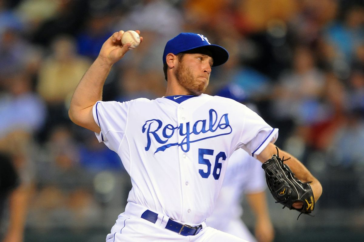 KANSAS CITY, MO - JUNE 6:  Reliever Greg Holland #56 of the Kansas City Royals throws a pitch against the Toronto Blue Jays at Kauffman Stadium on June 5, 2011 in Kansas City, Missouri. (Photo by G. Newman Lowrance/Getty Images)