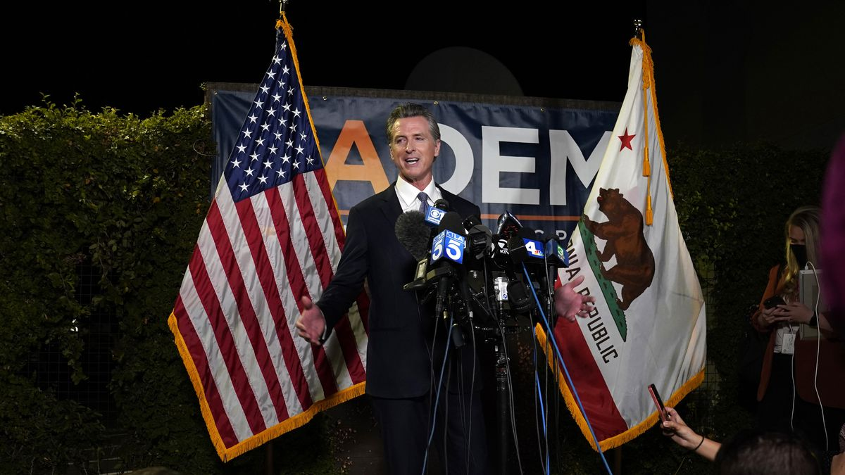 California Gov. Gavin Newsom talks to reporters after winning the recall election Tuesday.
