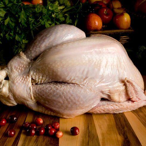 Raw turkey on a cutting board.