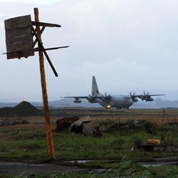 A military transport takes off from the Tacloban airport, Thursday, Nov. 21, 2013.