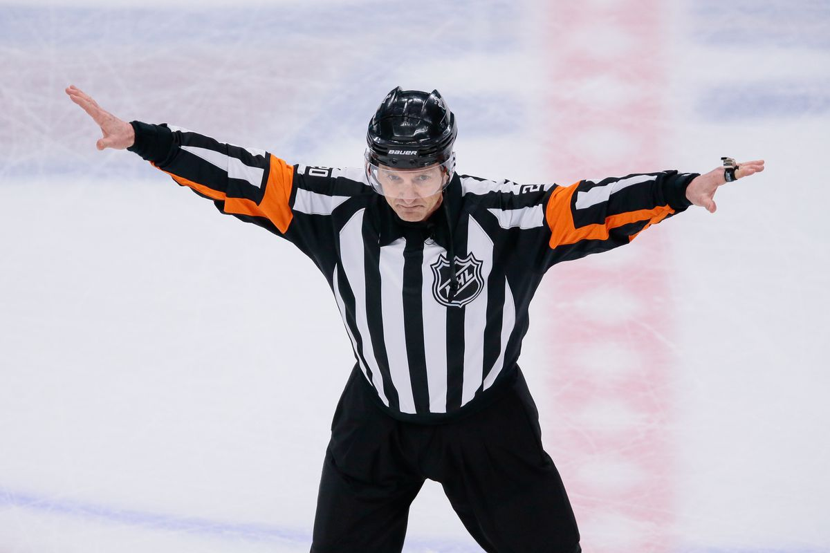 Referee Tim Peel waves off a Colorado Avalanche goal in the second period against the Nashville Predators in game six of the first round of the 2018 Stanley Cup Playoffs at the Pepsi Center.