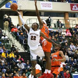 Morgan Park's Marcus Watson (22) lays the ball up as Young's DJ Steward defends.