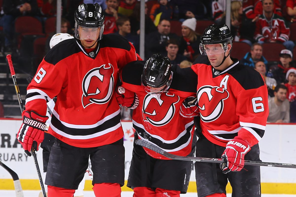 Dainius Zubrus and Andy Greene helped Damien Brunner off the ice after suffering a right knee injury.  A sight no one wants to see during a game.
