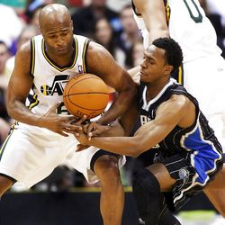 Utah Jazz guard Jamaal Tinsley (6) knocks the ball away from Orlando's #10 Ishmael Smith as the Utah Jazz and the Orlando Magic play Saturday, April 21, 2012 in Energy Solutions arena.