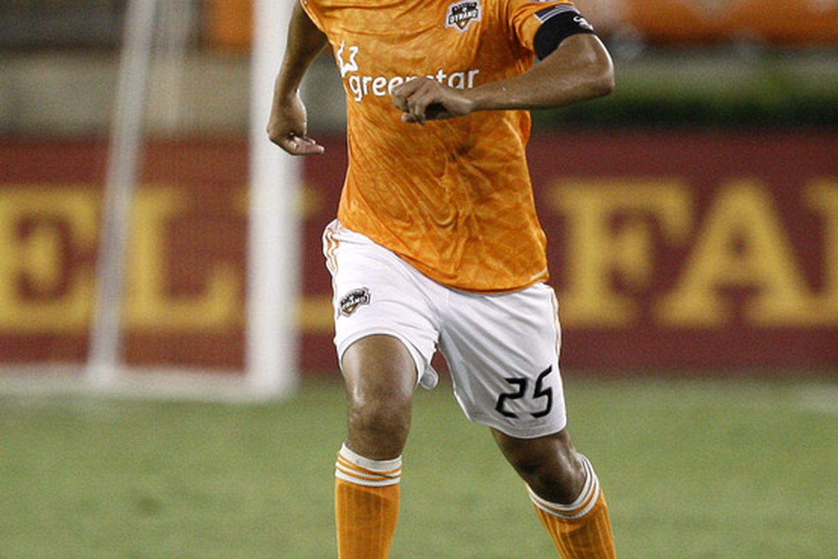 HOUSTON - SEPTEMBER 04:  Brian Ching #25 of the Houston Dynamo brings the ball up the field against Monterrey at Robertson Stadium on September 4, 2011 in Houston, Texas.  (Photo by Bob Levey/Getty Images)
