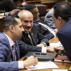 Ald. Ariel Reboyras (30th) chats with Alds. Felix Cardona Jr. (31st) and George Cardenas (12th) during the Chicago City Council meeting at City Hall, Wednesday, May 29, 2019.
