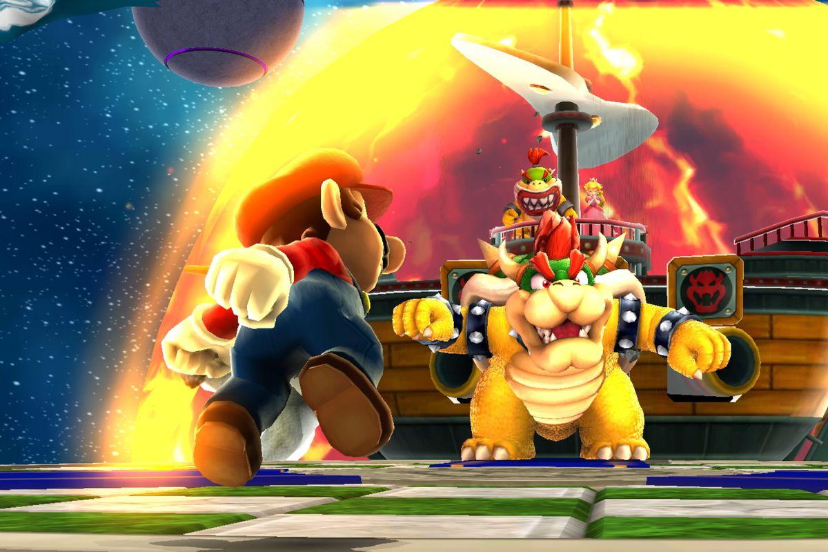 Mario runs toward Bowser aboard a ship in a screenshot from Super Mario Galaxy